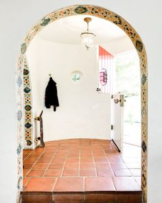 From domino.com - the California Casa you see in your dreams (sigh...love tiled archways...)