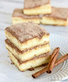 Love churros? Give these churro cheesecake bars a try! The recipe is easy and the results are amazing! #churrocheesecakebars #churrocheesecake #churro #cheesecakebars #creationsbykara #cinnamondessert