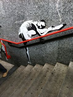 Looks like something Bansky would do. Not quite sure it is his work. Very clever!