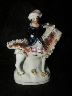 ANTIQUE STAFFORDSHIRE FIGURINE BOY SEATED  ON A GOAT FIG. 2361 VOL II HARDING