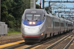 An image of an Amtrak Acela Express as it is running through Old Saybrook Connecticut