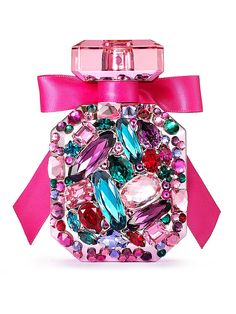 Bombshell Luxe Eau de Parfum - Sexy today, sexy tomorrow, sexy forever: it's the Bombshell you love, now in a collectible, limited-edition design with colorful Swarovski® crystals. Fragrance type: Fruity floral Notes: Purple passion fruit, Shangri-la peony and vanilla orchid Bottle tied with pink ribbon Includes lacquered box with lock and key 50 ml/1.7 fl. oz. Domestic