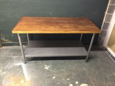 Heavy, sturdy industrial vintage metal based kitchen island with butcher block top. This piece has seen years of use and is ready for many more