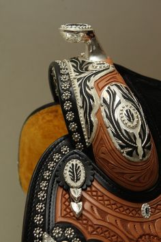 Dale Chavez Company Inc. Custom saddles, silver halters and awards buckles. OMG