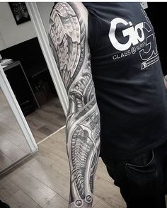 WEBSTA @ biomech_collective - Some great rhythms in this #blackandgrey #biomech #sleeve #tattoo by @dandwight_artist #mechanical #industrial #abstract
