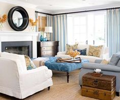 Refined Color Scheme     China Blue   Rosy Beige     A neutral foundation of rosy beige walls and white sofas allows pops of China blue to make a statement in this living room. Pattern takes shape in the blue damask ottoman (don't like) , the blue and white striped curtain panels (LOVE) , and pretty floral pillows (LOVE). Dark wood
