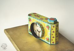 A happy little DIY camera photo frame!  https://www.etsy.com/listing/203357535/diy-paper-camera-photo-frame-colorful