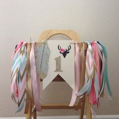 pow wow style high chair banner for baby girls first birthday. Stags head adorned with mini roses, glittery 1 and hand painted chip board feather.