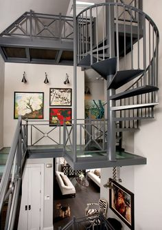 With a carefully designed stair and transparent catwalk, this mostly vertical space is put to great use!