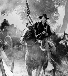 John Wayne. Nobody looked ever so in control, and good on his horse.  :-)