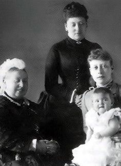 A smiling Queen Victoria with her youngest daughter Princess Beatrice (standing), her granddaughter and Beatrice's niece Princess Victoria of Battenberg (seated), and great-granddaughter Princess Alice of Battenberg | 1886. Alice, who was born deaf, married Prince Andrew of Greece and Denmark. They had four daughters and one son, Philip. In 1928 Philip was sent to live in England. He joined the Royal Navy in 1939 and married his third cousin Elizabeth (later Queen Elizabeth II) in 1947.