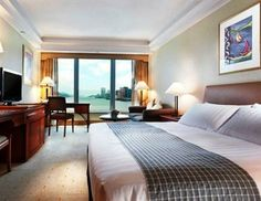 Rooms at the Harbour Grand Kowloon are comfortable and large, and feature a mini bar, in-room movies and slippers. Tea and coffee making fac...