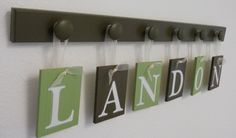 Baby loading surprise were pregnant pregnancy announcement reveal set includes 6 pegs and custom baby name landon painted light green and brown personalized baby gift via etsy negle Images