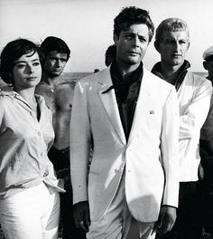 Marcello Mastroianni in a white suit.  La Dolce Vita final scene by Federico Fellini (1960)