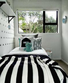 Un dormitorio infantil con toques turquesa y estilo nórdico