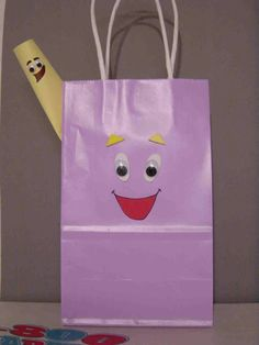 If we do the Dora theme like she says, these are cute, easy gift bags!