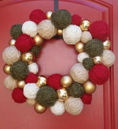 festive holiday wreath made with handwound yarn balls of varying sizes and gold ball
