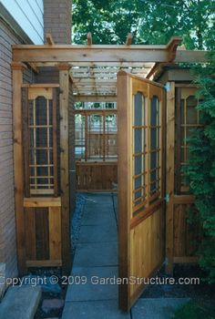 Arbor Gate Walkway - would be a cool outdoor space between the garage and the shed - put a little woodstove in there - cozy!