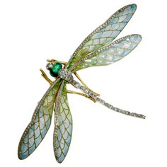 French Art Nouveau dragonfly brooch. This plique-a-jour enamel dragonfly with trembling wings sparkles with rose-cut diamonds...
