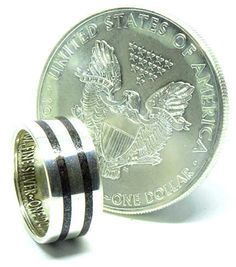 Hematite birthstone wedding ring hand made from an American silver eagle dollar coin Silver Eagle Coins, Silver Eagles, Wedding Ring Hand, Wedding Bands, Coin Ring, Dollar Coin, Unique Colors, Birthstones, Rings For Men
