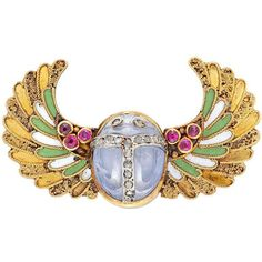 Egyptian Revival Enamel Sapphire Ruby Gold Scarab Brooch ($11,365) ❤ liked on Polyvore featuring jewelry, brooches, enamel jewelry, wing jewelry, cabochon jewelry, gold jewellery and enamel brooches