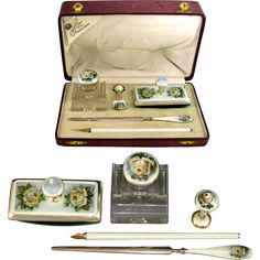An antique continental sterling silver and guilloche enamel 5 piece writing or desk set. The set consists of a hinged cut crystal inkwell decorated
