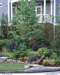 DIY:  How to Plan, Create and Plant a Dry Stream Bed - great info on how to fix drainage problems in your yard - via Fine Gardening
