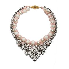 A divine statement piece from Shourouk, the Theresa necklace is white beads and faux-pearls encrusted with swarovski crystals and pastel painted stones. A contemporary take on diamonds and pearls.