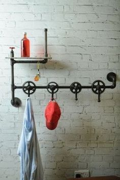 Bicycle Crank Hanger - On trend bike part furniture - The up cycling way for hanging your coat in your man cave abode. Also adapted with cool urban shelving for your man drinks and keeping your keys and smoking vaporizer stored on the shelf before you leave the house, you will never forget anything ever again. #bicyclehanger