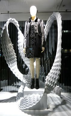 VM | Window Visual Merchandising | VM | Window Display | ....great flow...could you use bubble wrap and semi-sturdy wire to give same effect?