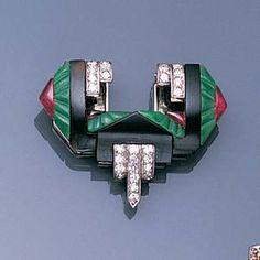 An art deco jade, onyx and ruby clip brooch, circa 1925. @designerwallace