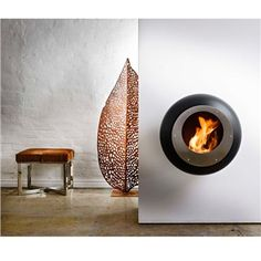 Cacoon Fireplaces  The ethanol-based fireplaces are smoke free and require no flue.  The Vellum Fireplace is lightweight and easily mounted on the wall.