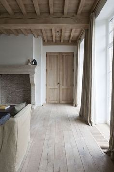 Love the bare wood ceiling/beams, doors, flooring. The wooden floor vent adds an interesting touch. Corvelyn
