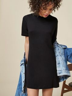We added a few inches to your favorite t-shirt and it's a dress now.  This is a short sleeve tshirt dress with a relaxed fit, oversized sleeve and crew neck.