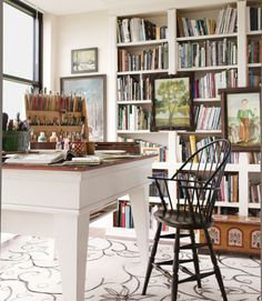 The owner of this Pennsylvania home built these bookcases and table for his wife's studio, while his wife painted the floral design on the rug by hand.   Bright idea: Personalize a rug with your own design, or a pretty stencil, using acrylic paint.