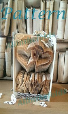Linked hearts and date book folding pattern. Comes with full set of numbers to make any date and re-use as many times as you need! The most popular engagement and Anniversary pattern. More Wedding themed patterns in the store! www.allinthefolds...