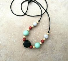 Cute teething necklace. Baby-proof jewellery. Sweet girlfriend, wife jewellery gift for mom, mum with small kids.  https://www.etsy.com/uk/listing/557953129/teething-necklace-whitewood-and-silicone