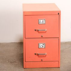 Peach Filing Cabinet... I should spray paint ours so I can store it inside and not out in the garage!
