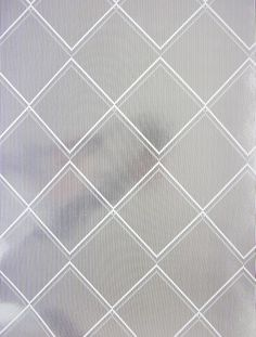 Argyle wallpaper, white and silver. Argyle is a panel effect wallpaper from Erica Wakerly's wallpaper Collection 03.