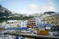 Port of Capri Island, Italy - Capri's main port is called Marina Grande and Marina Grande's beach is situated nearby - it is the is the largest beach on the island. There are charming cafes and restaurants along the waterfront where you can enjoy local food and the bustling port atmosphere.