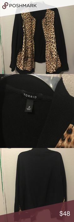 Torrid Animal print front bomber jacket size 2 This bomber jacket has sateen animal print front and fabric black with pockets its super comfy and perfect with tee and jeans throw on and go look worn twice EUC 100% polyester front and 60% cotton 40% polyester sleeves body torrid Jackets & Coats