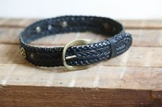 24-28 Thick wide vintage DKNY black braided leather belt with brass buckle and metal accents small medium ladies belt western