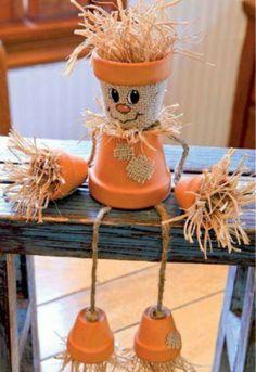 Pot scarecrow.  To cute....