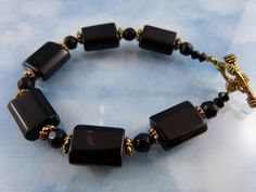 50% OFF ALL SHOP: Black Onyx Crystal & Gold Tone Bracelet.
