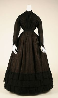 1867 American mourning dress. [Metropolitan Museum of Art] Another cotton example, very plain with lovely flounces at the bottom, and tight, trim sleeves. More gathering in the bodice than pleating as well, an interesting construction choice.