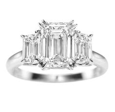 Three Stone Emerald Cut Engagement Rings