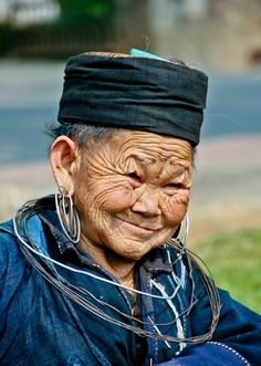 benevolent; photo and caption by Albert Tan. Shot taken at Vietnam, this beautiful old lady is a peddler