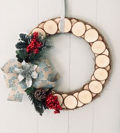 Hand-made rustic wreath from sliced wood. Accented with a festive blue burlap bow, cranberries, and pine. Farmhouse style decor perfect for Christmas and the whole winter season Christmas Craft Fair, Christmas Projects, Christmas Decorations, Christmas Ornaments, Holiday Decor, Wood Wreath, Burlap Wreath, Advent Wreath, Blog Deco