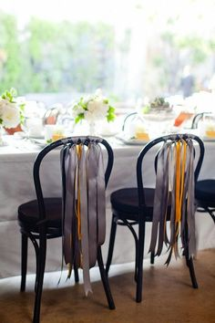 cover those ugly chairs with ribbons!