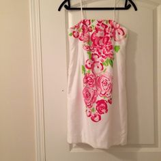 SALEStrapless Lilly Pulitzer dress Lilly Pulitzer strapless white dress with pink/green floral design down front. I do not know the name of this pattern. This dress was purchased from Lilly over 3 years ago(I don't remember exact year). GUC. No flaws. Size 2. Lilly Pulitzer Dresses Strapless